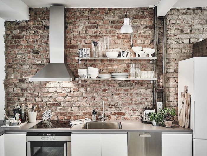 subway tile backsplash brick wall white cabinets gray countertop open shelving with wooden shelves
