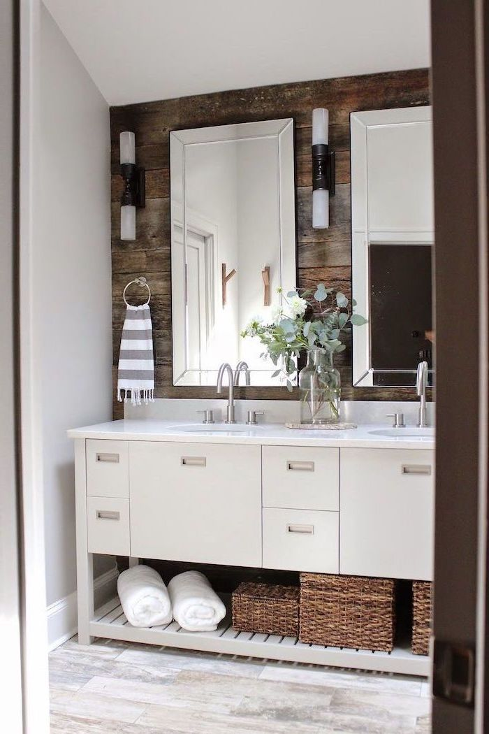 two mirrors on wooden wall above white cabinet with two sinks small bathroom remodel ideas wooden floor