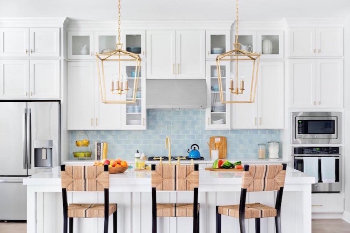 white cabinets and kitchen island kitchen backsplash tile light blue tiles for backsplash white countertops two pendants hanging above the kitchen island