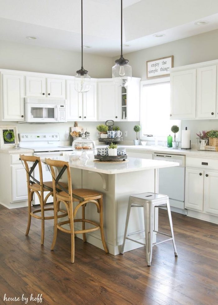 white cabinets white countertops modern farmhouse decor ideas wooden bar stools next to white kitchen island dark wooden floor