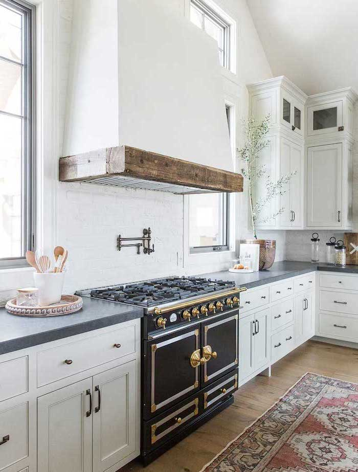 white cabinets with black granite countertop farmhouse kitchen decor ideas black stove colorful carpet on wooden floor