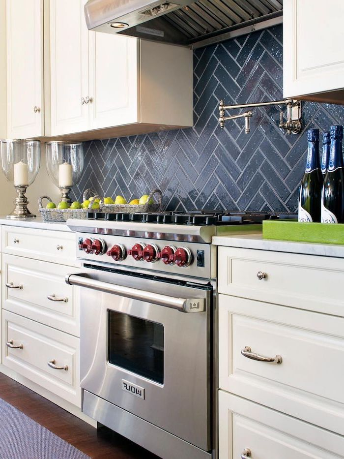 white cabinets with white countertops kitchen backsplash tile black tiles above the stove wooden floor