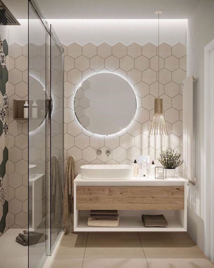 white honeycomb tiles floating wooden cabinet round mirror with led light glass shower cabin small bathroom remodel