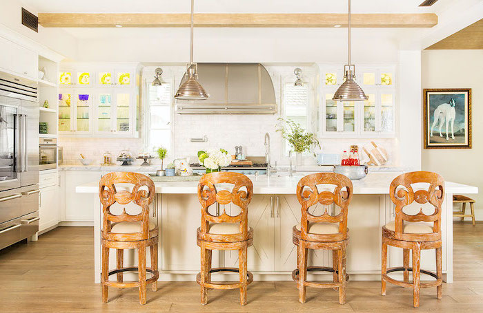 white kitchen island with wooden bar stools farmhouse white kitchen cabinets marble countertops wooden floor