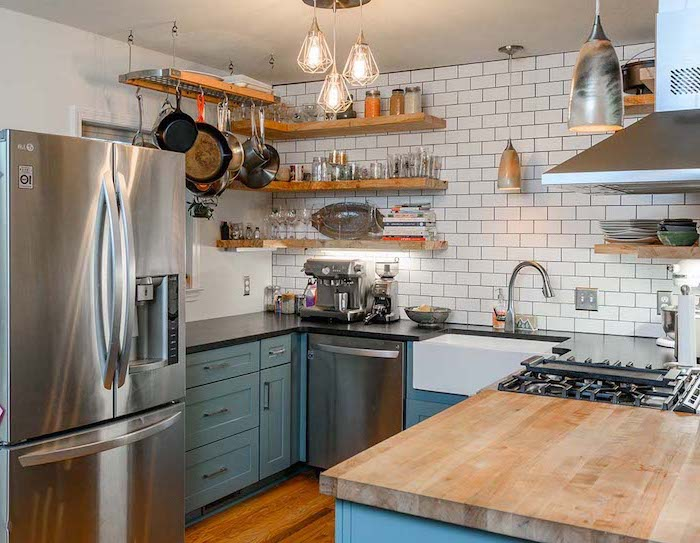 white subway tiles backsplash white farmhouse kitchen blue cabinets black countertops open shelving wooden floor