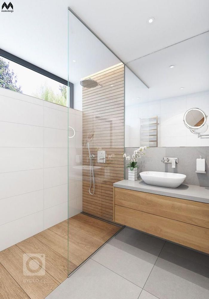white tiles on the wall and floor wooden accent wall and floor in the shower floating cabinet with large mirror