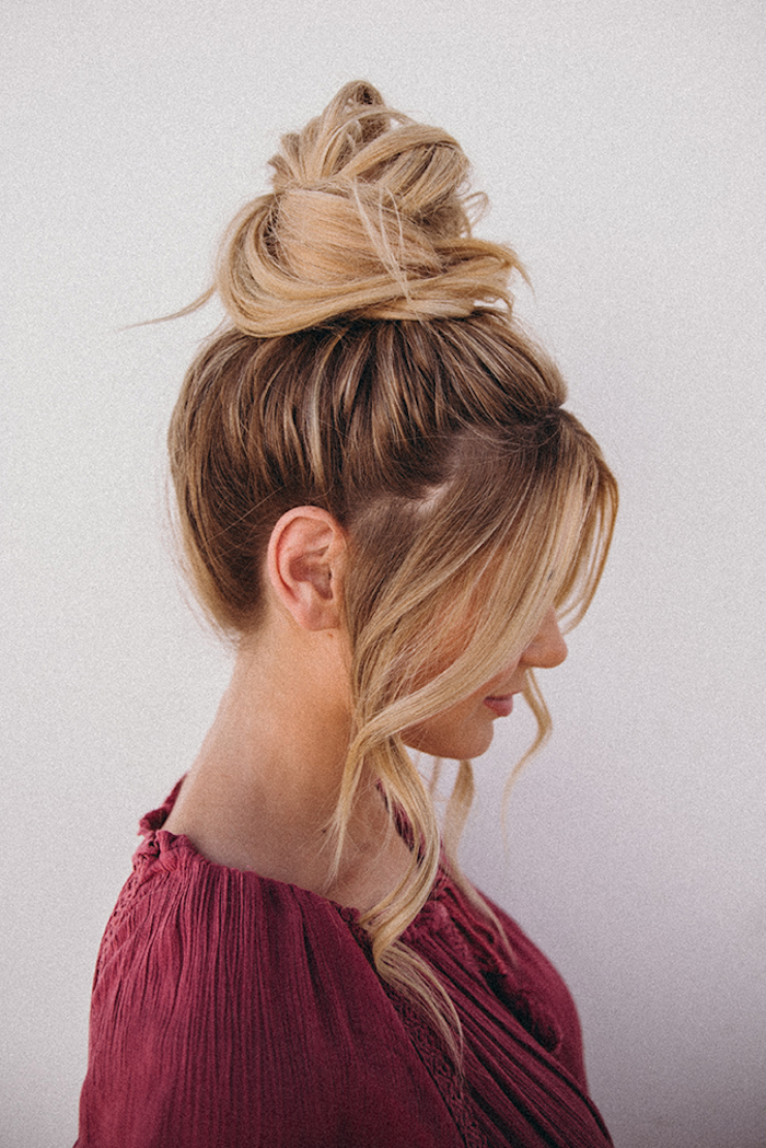 woman wearing dark burgundy blouse cute easy hairstyles for school dark blonde hair with highlights hair in a bun two strands of hair in front
