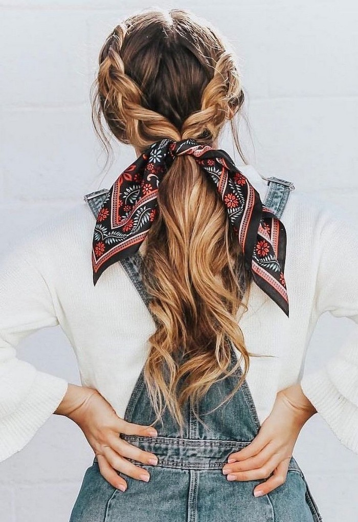 woman wearing white blouse denim overalls cute hairstyles for girls brunette hair with blonde highlights in two braids tied with a silk scarf