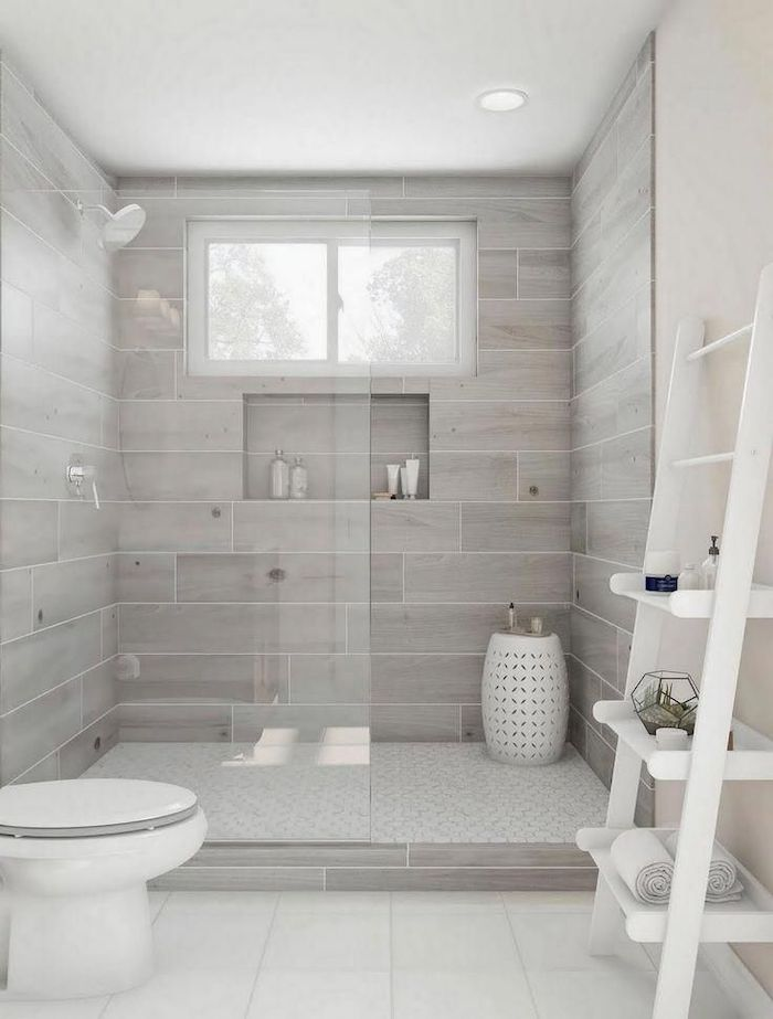 wooden walls in the shower cabin white tiles on the floor how to decorate a bathroom white shelves leaning on white wall