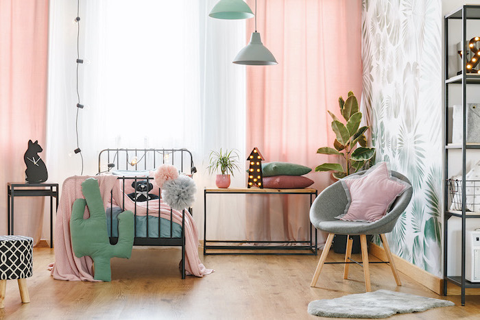 accent wall with palm leaves pink curtains teenage girl beds single bed with black metal frame wooden floor
