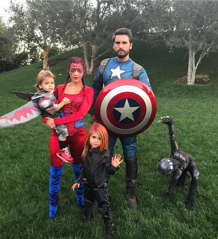 ant man black panther black widow kourtney kardashian and scott dissick with their kids dressed as spider man captain america halloween costumes for 3 people photographed on green field