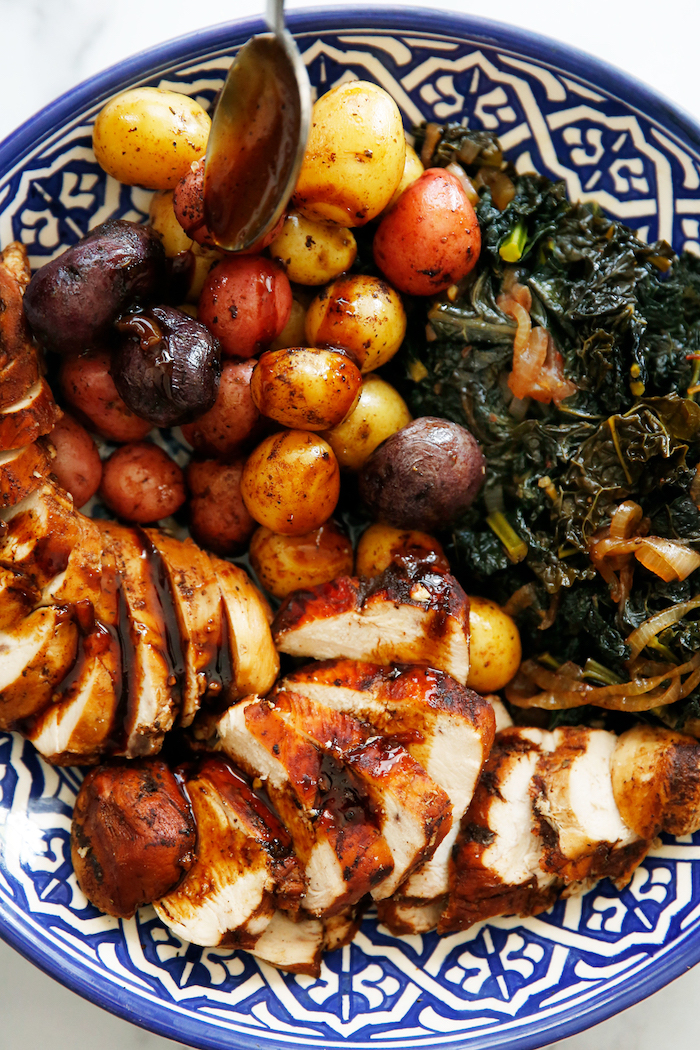 balsamic chicken breast with side of roasted potatoes cooked kale instant pot recipes blue and white ceramic plate