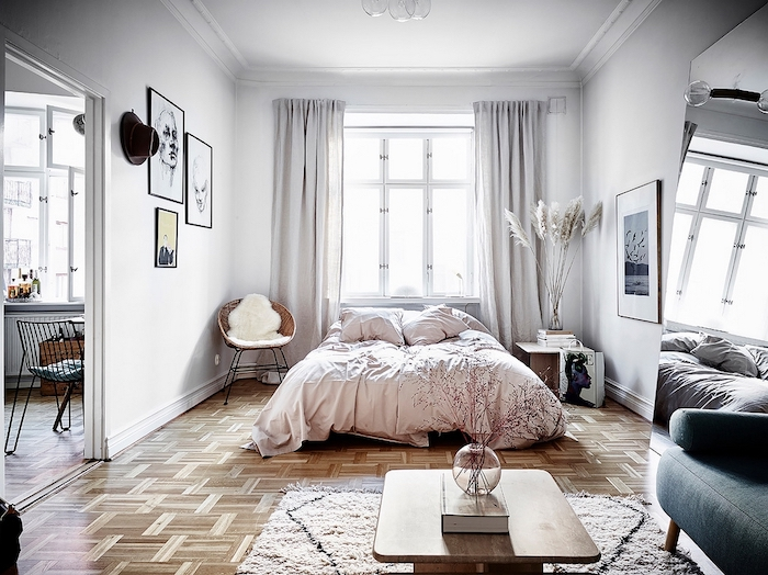 bedroom decor in white with wooden floor pampas grass decor glass vase with pampass grass on the night stand