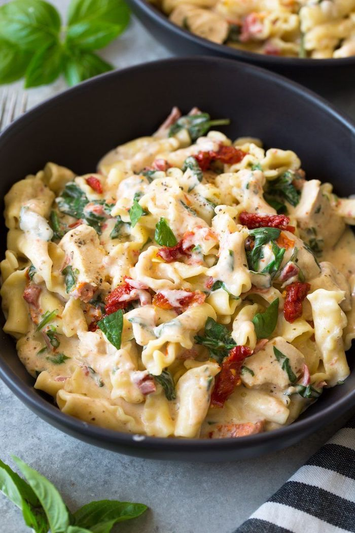 best pressure cooker recipes chicken pasta with sun dried tomatoes cooked in instant pot garnished with basil leaves