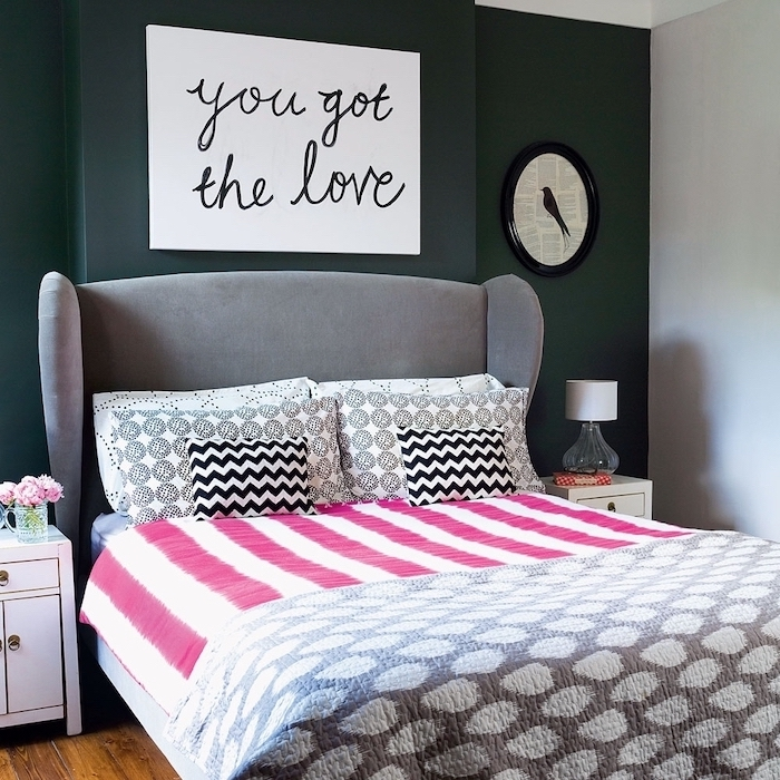 black accent wall behind the bed with gray velvet headboard room decor ideas for girls bed linen and throw pillows in white black pink gray