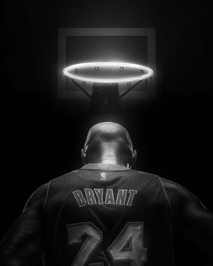 black and white photo kobe bryant and gigi wallpaper kobe photographed from the back wearing number twenty four on lakers jersey baskeyball hoop above him as halo