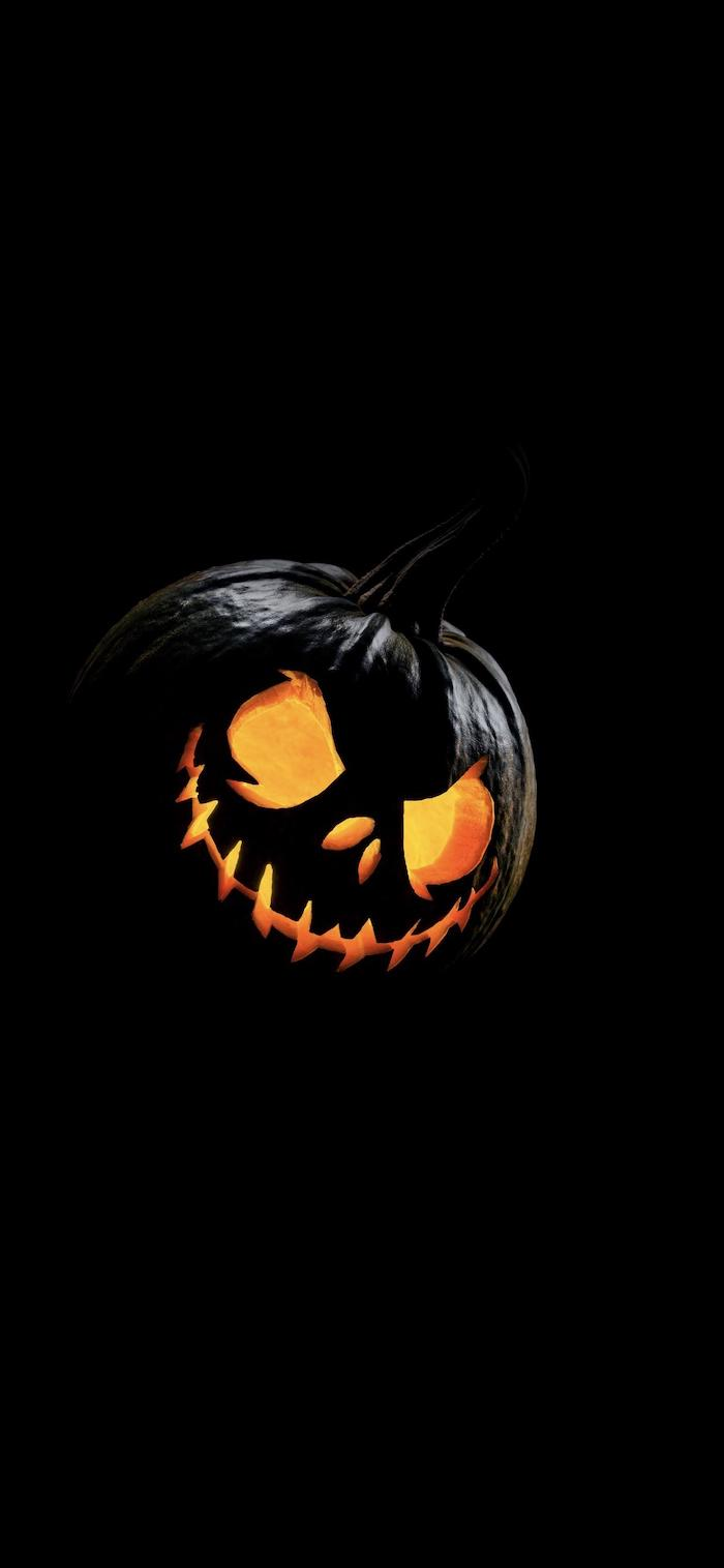 black background halloween background images jack o lanterns with scary expression painted in black