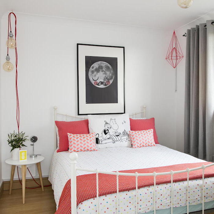 black framed art above the bed with white metal frame cute room ideas for a teenage girl white pink throw pillows and blankets