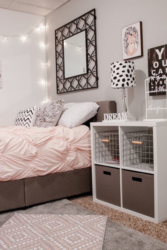 black framed mirror above bed with gray white black throw pillows cute room ideas for a teenage girl night stand next to it