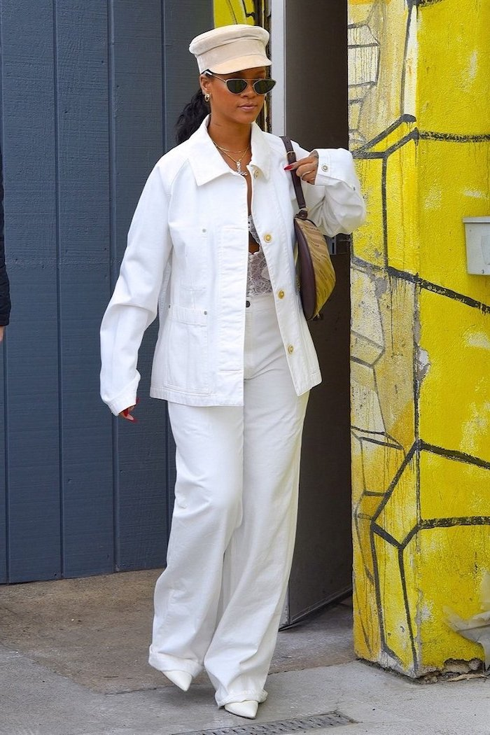 black haired rihanna wearing all white cute outfit ideas white jeans white denim jacket hat white shoes sunglasses
