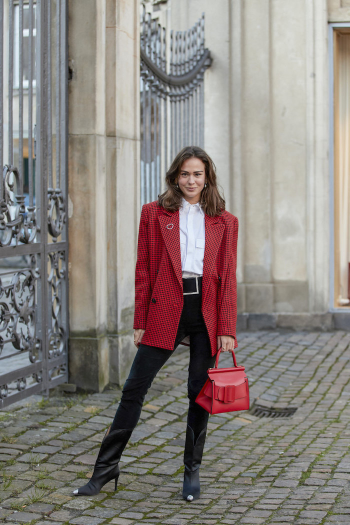 black jeans white t shirt black leather boots red over sized blazer and bag cute outfit ideas for girl worn by woman with shoulder length brown hair
