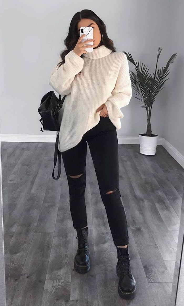 black jeans with white oversized sweater cute outfits for women black combat boots worn by woman with long black hair
