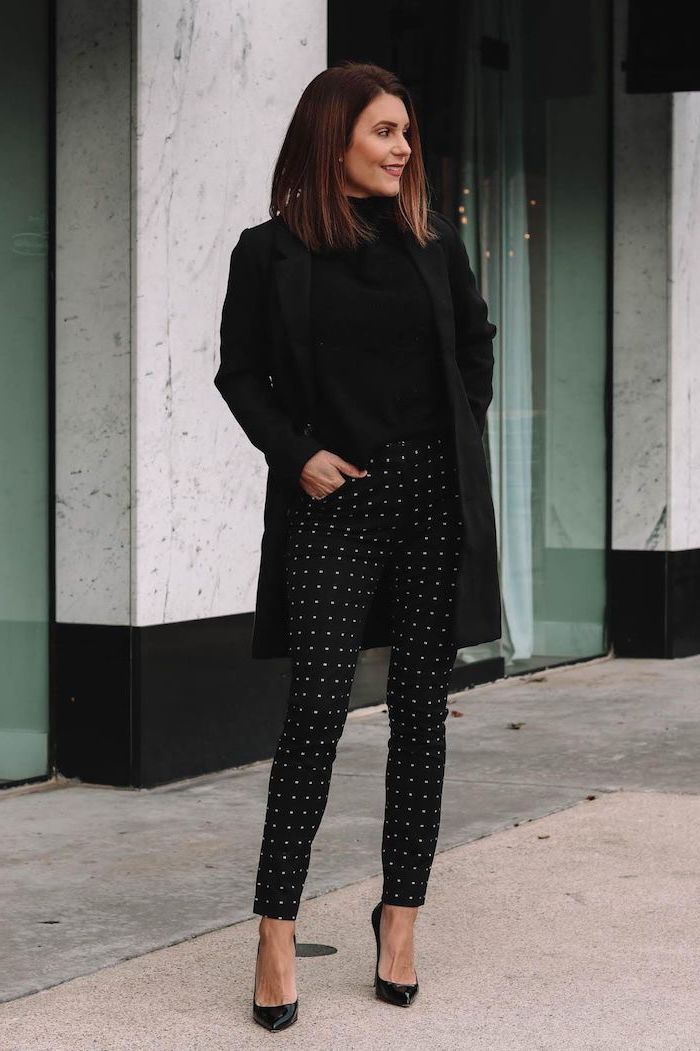 black outfit worn by woman with shoulder length brown hair cute outfits for women black trousers with white dots black blouse coat and shoes