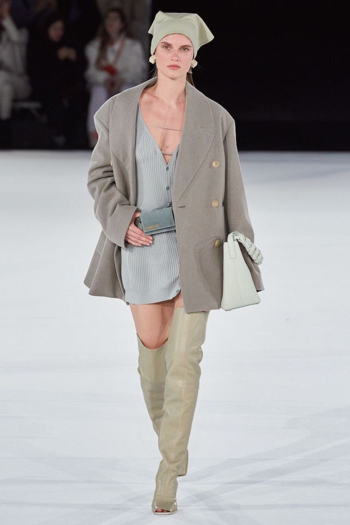 blue knitted dress grey coat thigh high leather boots cute trendy outfits worn by model walking down the runway