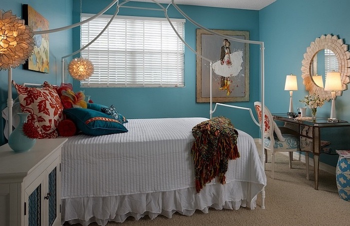 blue walls with framed art pieces teenage girl beds white metal canopy bed with colorful throw pillows