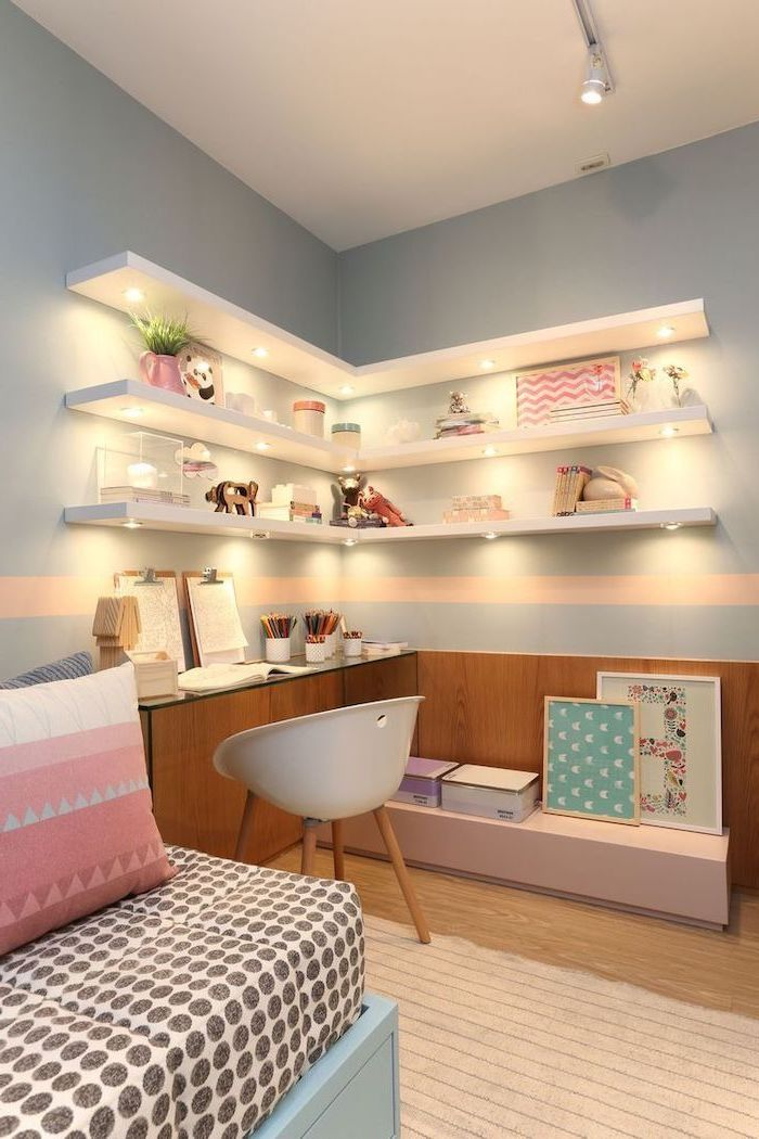 bookshelves with led lights on light blue wall above desk teenage girl bedroom ideas wooden floor pink throw pillows on the bed