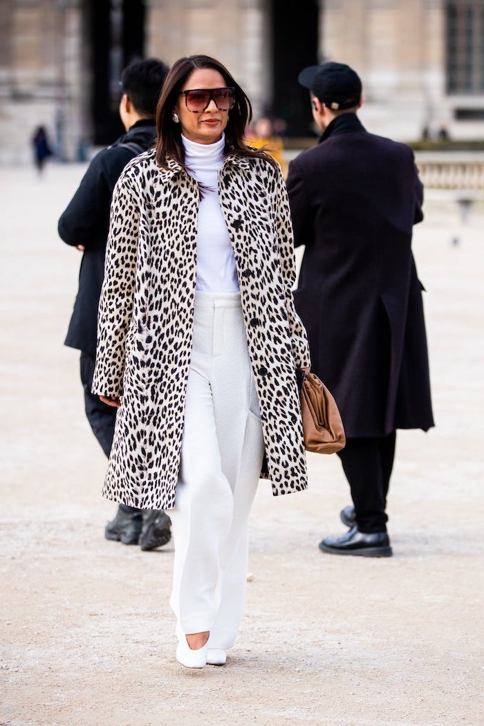 brunette woman with sunglasses walking down the street pinterest cute outfits white blouse trousers shoes leopard print coat