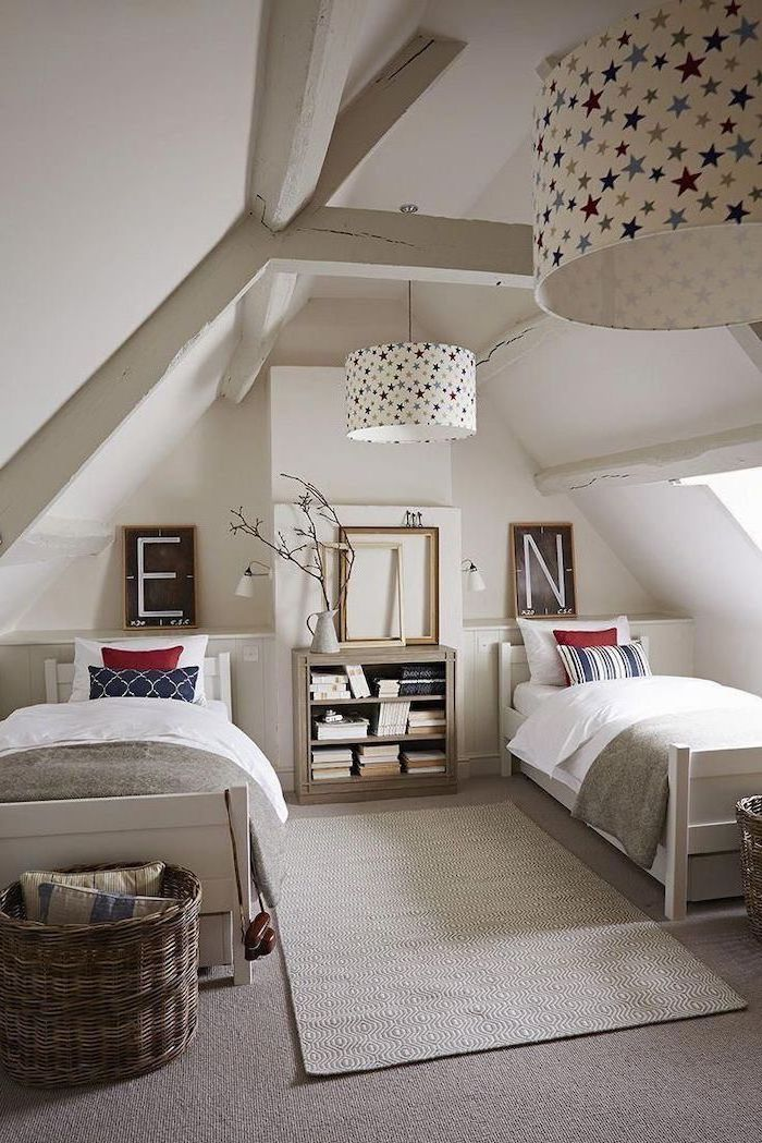cathedral ceiling with exposed wood beams two single beds bookshelf between them teen girl room ideas gray carpet