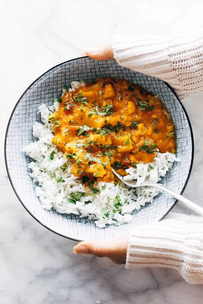 cauliflower curry instant pot one pot meals white rice with chopped parsley inside black and white ceramic bowl