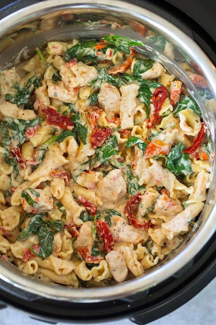 chicken pasta cooked in instant pot best pressure cooker recipes with sun dried tomatoes and basil leaves