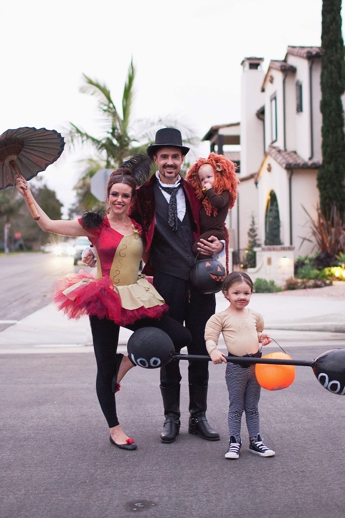 circus artists family of 3 halloween costumes dad as magician mom as acrobatic performer photographed on the street