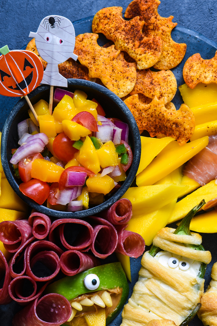 crackers in the shape of bats salad with mango cherry tomatoes onion easy halloween appetizers salami peppers wrapped in dough