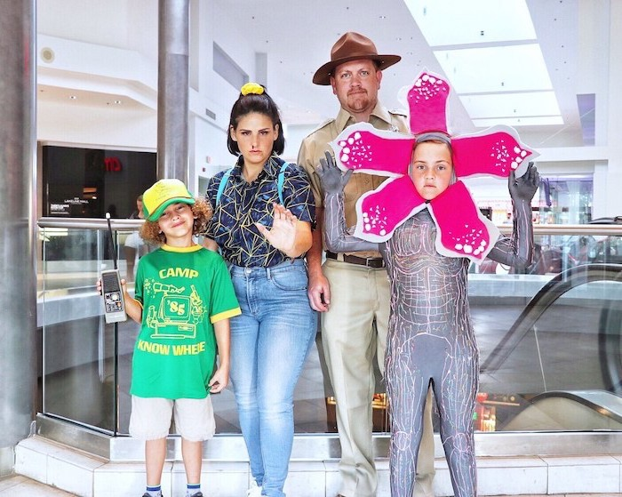 dad dressed as hhopper mom as eleven kid as dustin kid as the demogorgon family halloween costumes with baby stranger things inspired costumes
