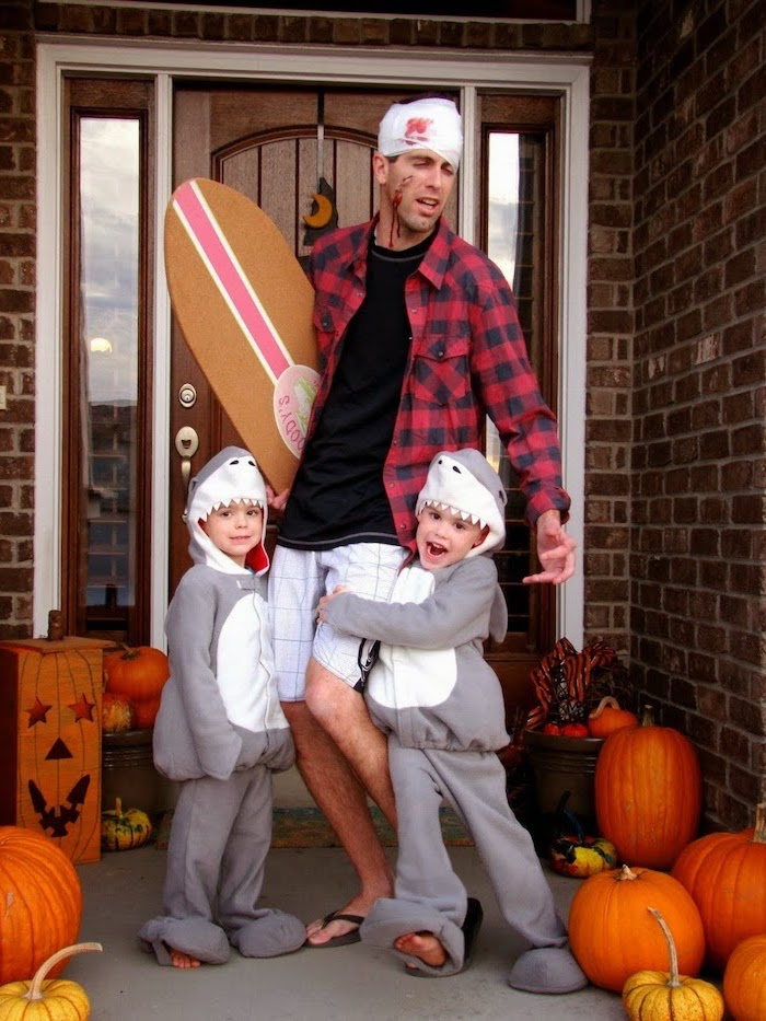 dad dressed as surfer attacked by sharks family halloween costumes with baby two kids dressed as sharks