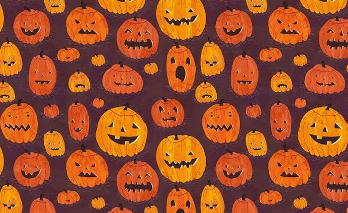 dark purple background drawings of carved pumpkins in different shades of orange halloween wallpaper with different expressions