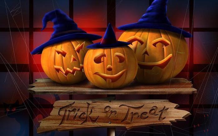 digital drawing of three carved pumpkins with dark blue hats halloween iphone wallpaper trick or treat wooden sign