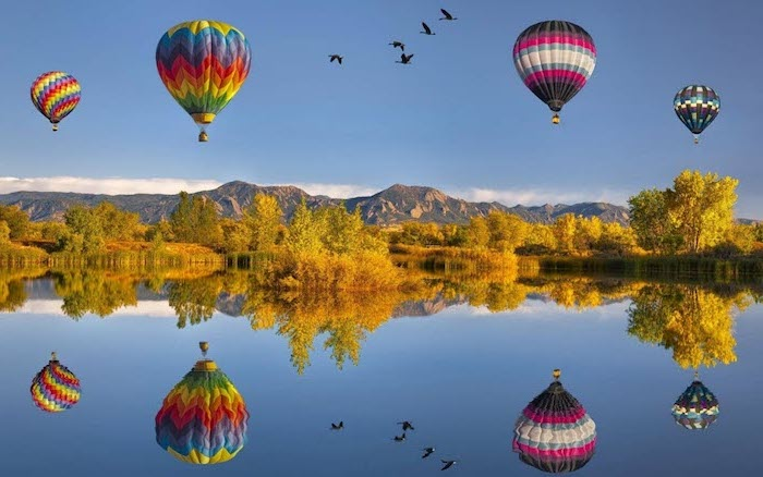 fall desktop backgrounds four hot air balloons flying over a lake surrounded by trees mountain range in the background