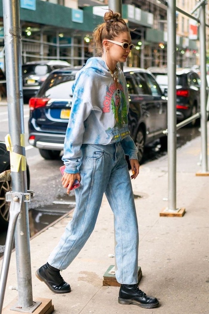 fall outfits for women gigi hadid walking on the sidewalk wearing baggy washed jeans tie dye sweatshirt black leather combat boots