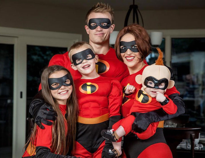 family of five dressed as the characters from the incredibles family halloween costumes with baby photographed together smiling