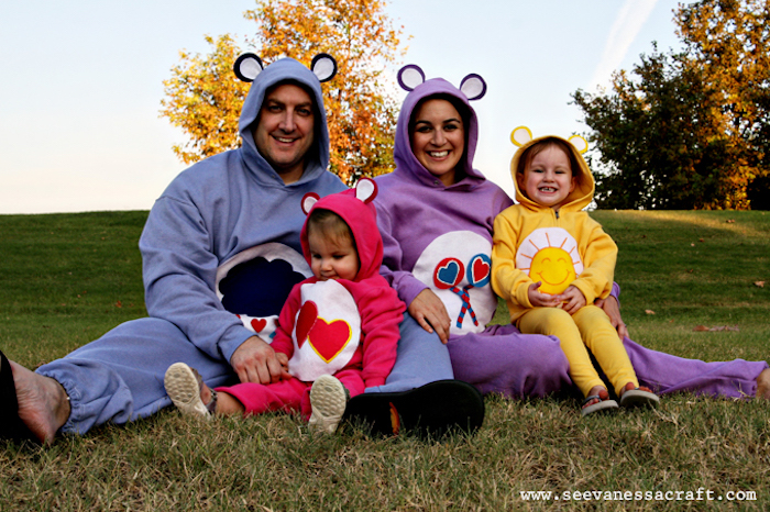 family of four dressed as care bears sitting on green grass field diy family halloween costumes