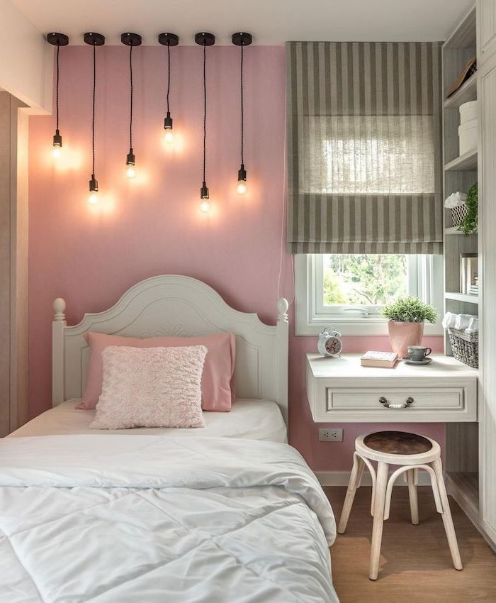 floating desk next to the bed teenage girl bedroom ideas for small rooms pink wall with hanging lamps with different length above the bed