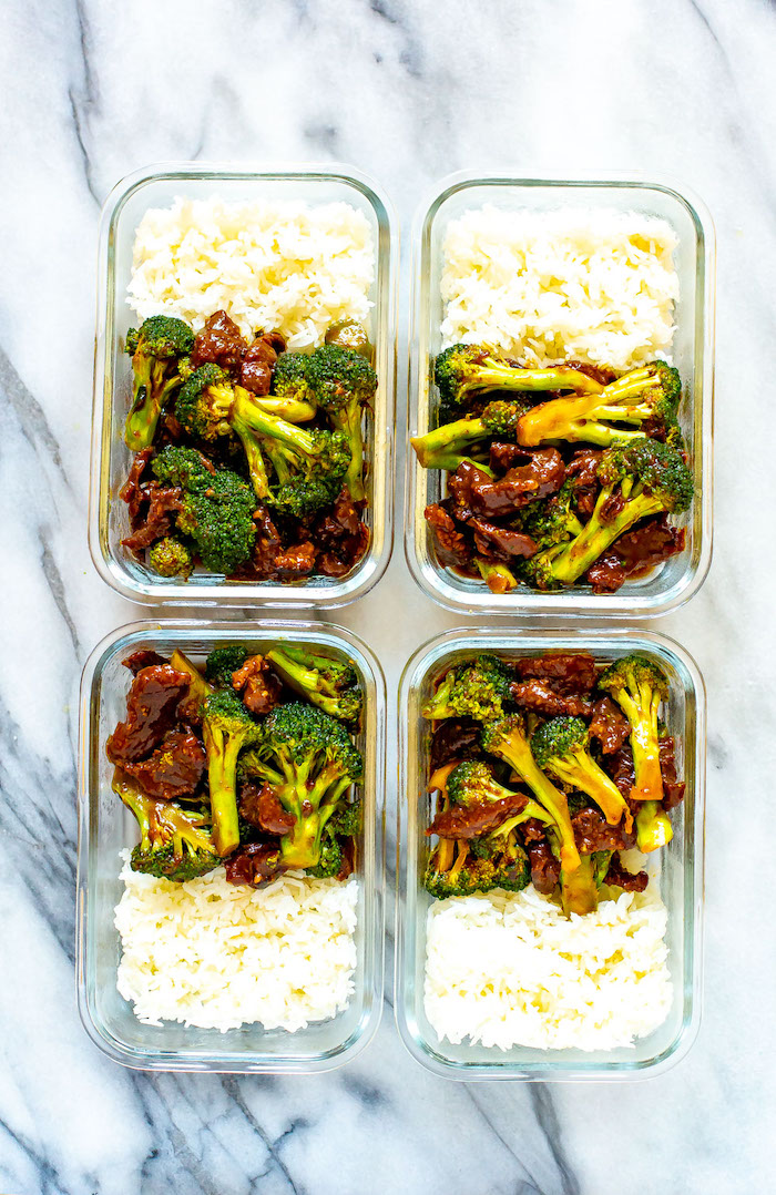 four glass boxes filled with beef and broccoli and white rice placed on marble surface best instapot recipes meal prep