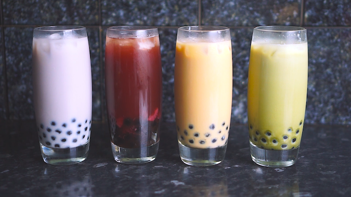 four glasses filled with bubble tea in different colors what is boba made of purple red orange green