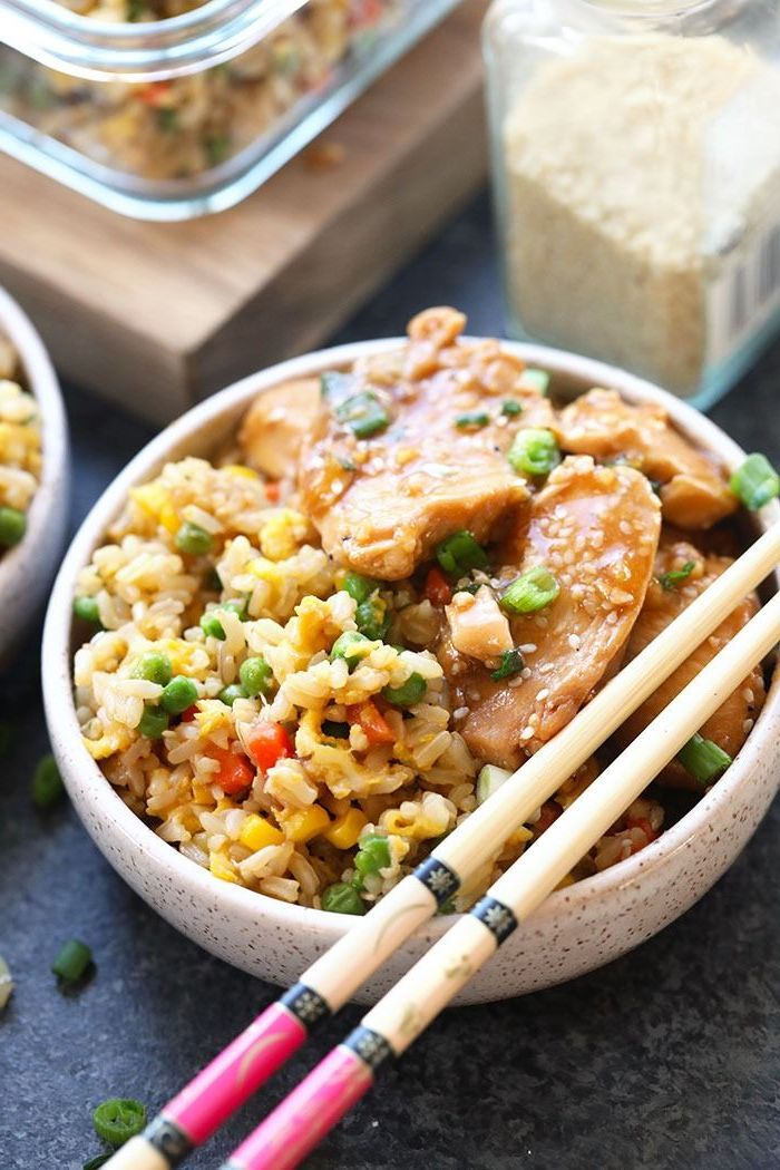 fried rice with chicken quick instant pot recipes garnished with chives and sesame seeds inside ceramic bowl