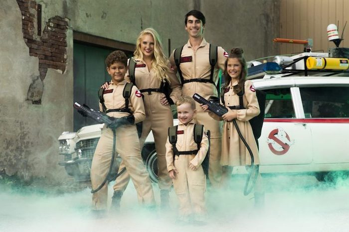 ghostbusters costumes mom dad and three kids standing in front of the ghostbusters car halloween costumes for 3 people