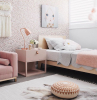gold dots on white wall pink velvet sofa single bed pink night stand teen girl room decor white carpet on the floor with small sitting pillow